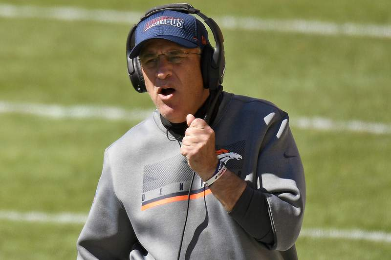 Denver Broncos head coach Vic Fangio walks the sideline during the first half of an NFL football game against the Pittsburgh Steelers in Pittsburgh, Sunday, Sept. 20, 2020. The Broncos play the New England Patriots on Sunday, Oct. 11. (AP Photo/Don Wright)
