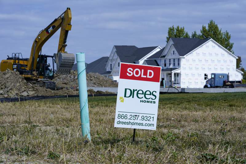 """A """"sold"""" sign sits on a lot as new home construction continues in Westfield, Ind., Friday, Sept. 25, 2020. U.S. home construction rose a solid 1.9% in September after having fallen in August as home building remains one of the bright spots for the economy.  (AP Photo/Michael Conroy)"""
