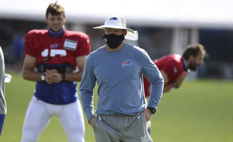Buffalo Bills Head Coach Sean McDermott runs practice form the middle of the field with a mask on during the second day of training camp opened to the media at ADPRO Sports Training Center's outdoor field in Orchard Park, N.Y., Tuesday, Aug. 18, 2020. P (James P. McCoy/Buffalo News via AP, Pool)