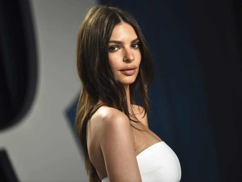 FILE - Model Emily Ratajkowski arrives at the Vanity Fair Oscar Party in Beverly Hills, Calif., on Feb. 9, 2020. The British model and activist has a book deal. She is working on an essay collection called My Body. Metropolitan Books will publish it in 2022. (Photo by Evan Agostini/Invision/AP, File)