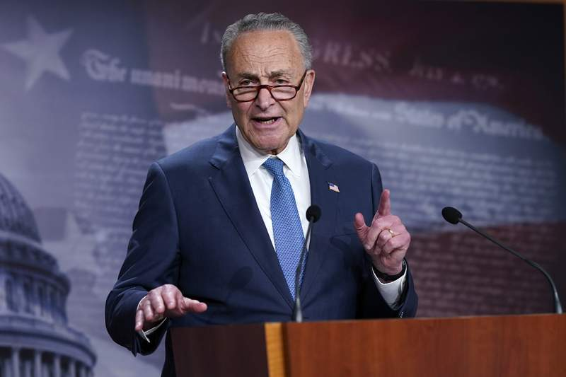 """Senate Majority Leader Chuck Schumer, D-N.Y., speaks to reporters at the Capitol in Washington. Schumer warned his Democratic colleagues that June will """"test our resolve"""" as senators return Monday to consider infrastructure, voting rights and other priorities. Six months into Democrats' hold on Washington, the senators are under enormous pressure to make gains on Democrats' campaign promises. (AP Photo/J. Scott Applewhite, File)"""