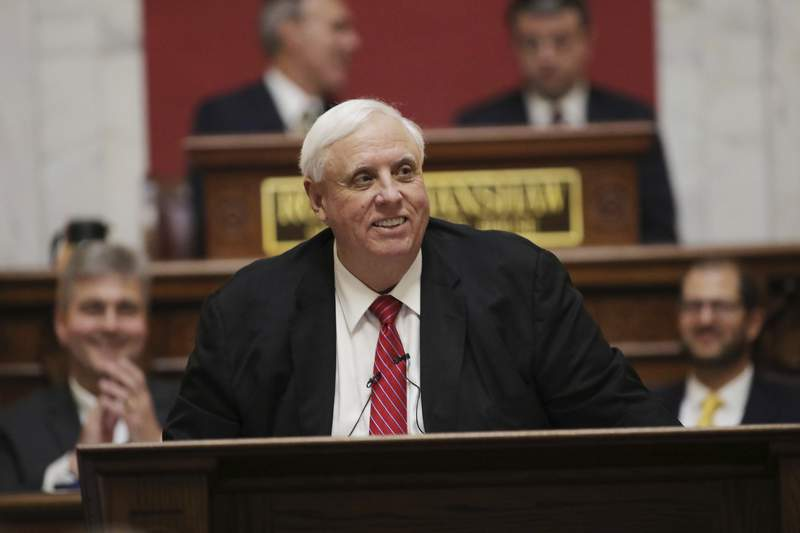 FILE - In this Jan. 8, 2020, file photo, West Virginia Governor Jim Justice delivers his annual State of the State address in the House Chambers at the state capitol in Charleston, W.Va. West Virginia's state airplane can make side trips to Gov. Justice's hometown as well as fly him to campaign events if the trips coincide with official state business, ethics officials ruled Thursday, March 5, 2020. (AP Photo/Chris Jackson, File)