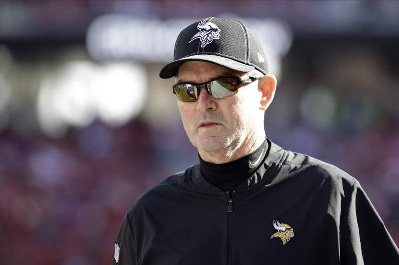 FILE - In this Jan. 11, 2020, file photo, Minnesota Vikings head coach Mike Zimmer walks on the field before an NFL divisional playoff football game against the San Francisco 49ers in Santa Clara, Calif. With a new offensive coordinator this season in 58-year-old Gary Kubiak, Zimmer, 64, has renewed energy for the job of trying to take the Vikings to that Super Bowl the franchise has never won.  (AP Photo/Marcio Jose Sanchez, File)