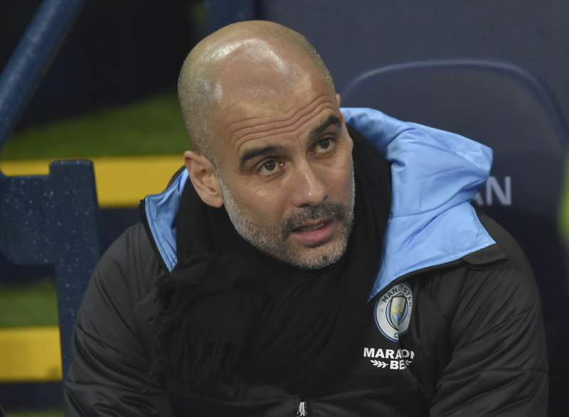 Manchester City's head coach Pep Guardiola ahead of the English Premier League soccer match between Manchester City and West Ham at Etihad stadium in Manchester, England, Wednesday, Feb. 19, 2020. (AP Photo/Rui Vieira)