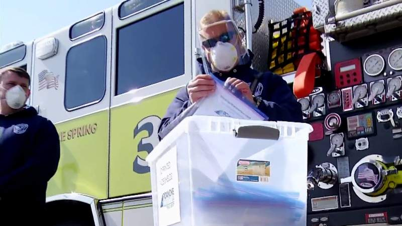 Library employees donate face shields to first responders