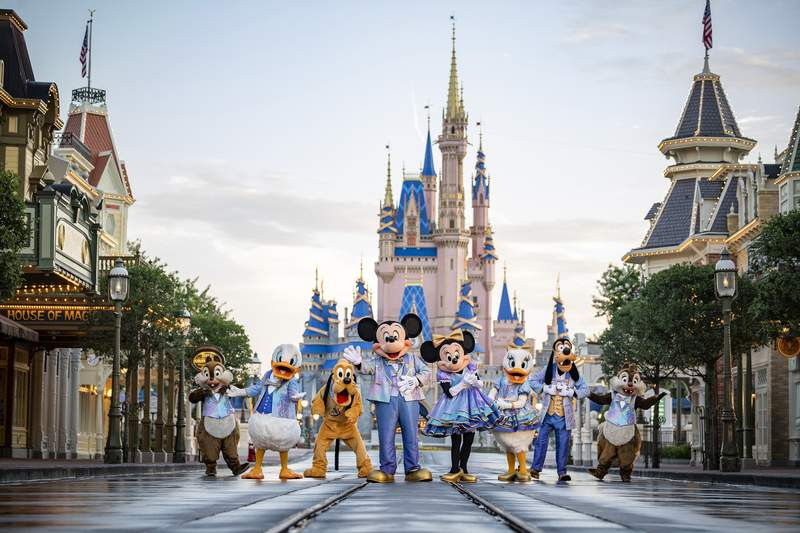 """This undated photo provided by Walt Disney World shows Disney characters at Walt Disney World in Lake Buena Vista, Fla. Walt Disney World is planning an 18-month celebration in honor of its 50th anniversary, starting in October 2021. Disney announced Tuesday, June 22 that all four parks at the resort will take part in The Worlds Most Magical Celebration."""" (Matt Stroshane/Walt Disney World via AP)"""