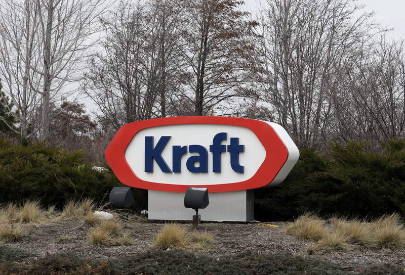 FILE - This Wednesday, March 25, 2015, file photo shows the Kraft logo outside of the company's headquarters in Northfield, Ill.   Kraft Heinz Co. is agreeing to pay $62 million to settle charges of improper accounting of what it once claimed were cost savings. Two former senior executives have agreed to pay civil penalties. The Securities and Exchange Commission said Friday, Sept. 3, 2021,  that from late 2015 through 2018, Kraft boasted about cost savings that were actually unearned discounts and gave false reports about contracts with suppliers.   (AP Photo/Nam Y. Huh, File)