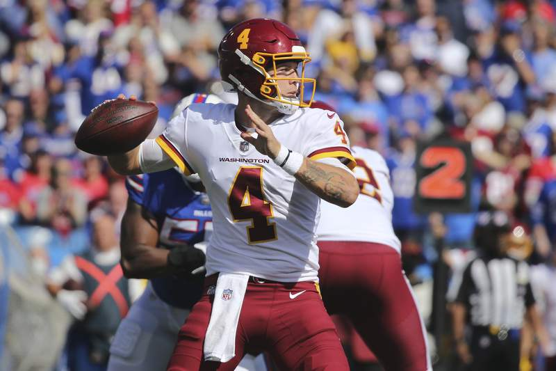 Washington Football Team quarterback Taylor Heinicke (4) throws a pass during the first half of an NFL football game against the Buffalo Bills Sunday, Sept. 26, 2021, in Orchard Park, N.Y. (AP Photo/Jeffrey T. Barnes)