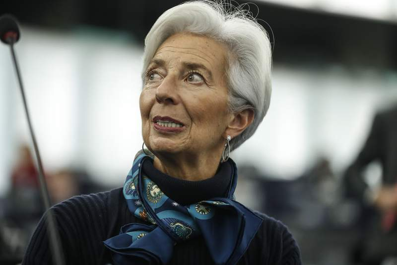 FILE - In this Tuesday Feb. 11, 2020 file photo, Christine Lagarde president of the ECB looks up prior to deliver her speech before the European Parliament's economic and monetary affairs committee at the European Parliament in Strasbourg, France. The head of the European Central Bank says that the economic recovery risks losing momentum due to the second wave of coronavirus infections and that the chief monetary authority for the euro countries could add more stimulus if that becomes necessary.  (AP Photo/Jean-Franois Badias, File)