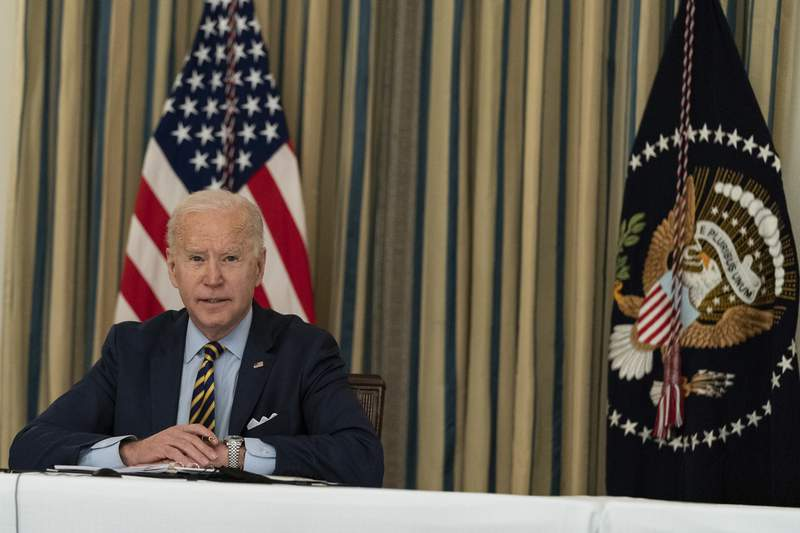 President Joe Biden speaks during a virtual meeting with Indian Prime Minister Narendra Modi, Australian Prime Minister Scott Morrison and Japanese Prime Minister Yoshihide Suga, from the State Dining Room of the White House, Friday, March 12, 2021, in Washington. (AP Photo/Alex Brandon)