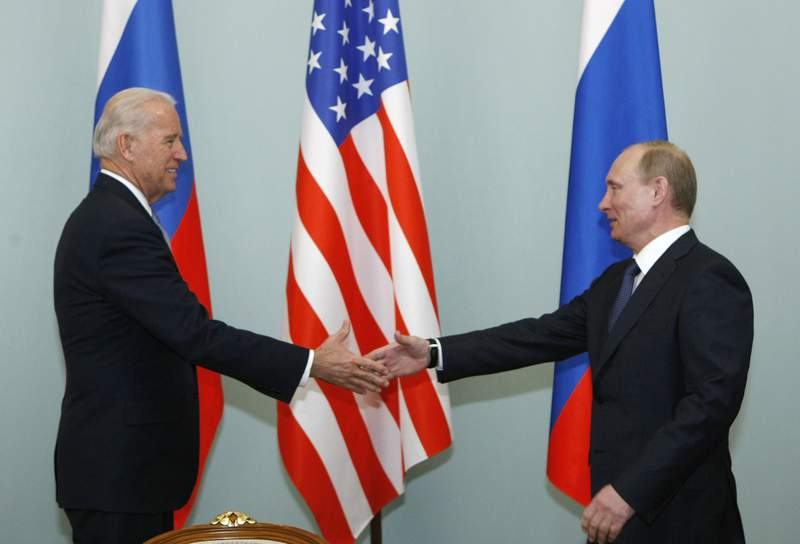 FILE - In this March 10, 2011, file photo, Vice President of the United States Joe Biden, left, shakes hands with Russian Prime Minister Vladimir Putin in Moscow, Russia. Russian President Vladimir Putin has congratulated Joe Biden on winning the U.S. presidential election after weeks of holding out. Putin's message to Biden on Tuesday, Dec. 15, 2020, came a day after the Electoral College confirmed Biden as the nation's next president. The Russian president is one of the last world leaders to congratulate Biden. (AP Photo/Alexander Zemlianichenko, File)