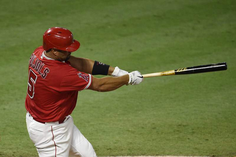Los Angeles Angels' Albert Pujols follows through on a swing for a two-run double during the fifth inning of a baseball game against the San Francisco Giants in Anaheim, Calif., Monday, Aug. 17, 2020. (AP Photo/Kelvin Kuo)