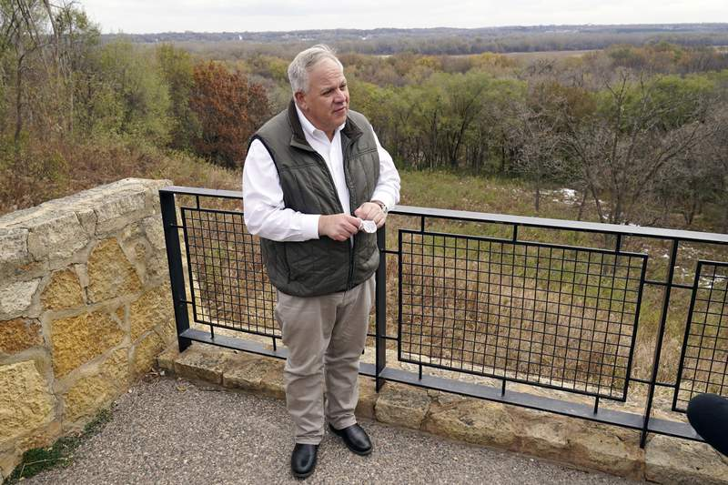 """Interior Secretary David Bernhardt takes reporters' questions overlooking the Minnesota River area after he announced the gray wolf's recovery """"a milestone of success during a stop at the Minnesota Valley National Wildlife Refuge, Thursday, Oct. 29, 2020, in Bloomington, Minn. The move stripped Endangered Species Act protections for gray wolves in most of the U.S., ending longstanding federal safeguards and putting states and tribes in charge of overseeing the predators. (AP Photo/Jim Mone)"""