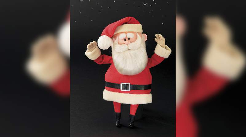 """This image released by Profiles in History shows a Santa Claus puppet used in the filming of the 1964 Christmas special """"Rudolph the Red-Nosed Reindeer."""" A buyer shouted out with glee that they would pay $368,000 for the Rudolph and Santa Claus figures used in the perennially beloved Christmas special Rudolph the Red Nosed Reindeer.  Bidding for the figures soared past the projected sale price of between $150,000 and $200,000 on Friday, Nov. 13, 2020 at the Icons & Legends of Hollywood Auction held in Los Angeles by Profiles in History. (Profiles in History via AP)"""