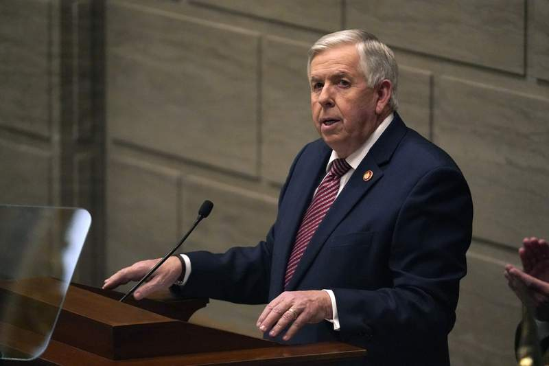 """FILE - In this Jan. 27, 2021 file photo, Missouri Gov. Mike Parson delivers the State of the State address in Jefferson City, Mo. Federal officials are pushing back after Parson said he doesn't want government employees going door-to-door to urge people to get vaccinated. Missouri asked for help last week from nearly formed federal """"surge response"""" teams as it combats an influx of cases that's overwhelming some hospitals. (AP Photo/Jeff Roberson, File)"""