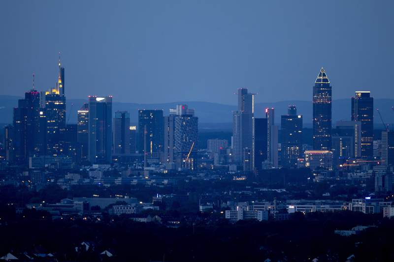 The buildings of the banking district are seen in Frankfurt, Germany, at dawn on early Sunday, May 31, 2020. (AP Photo/Michael Probst)