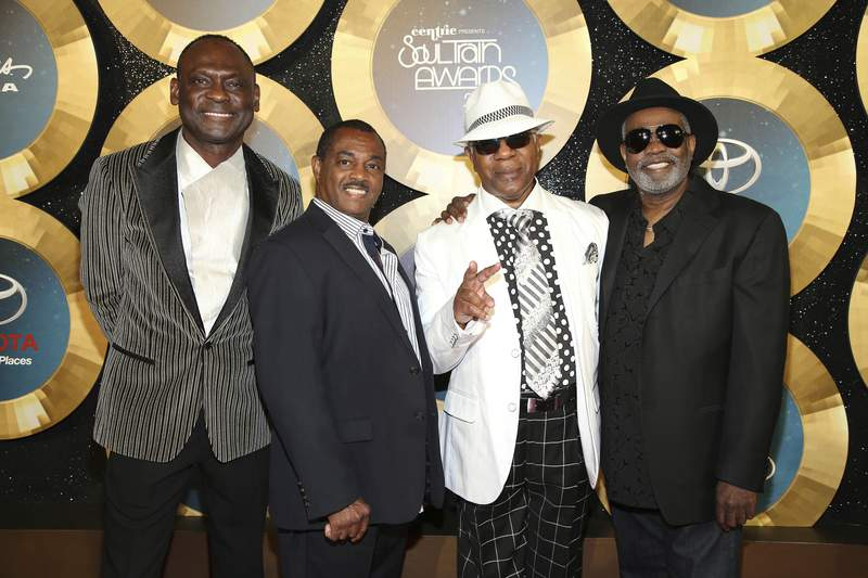 FILE - In this Nov. 7, 2014 file photo, George Brown, Ronald Bell, Dennis Thomas and Robert 'Kool' Bell of Kool and the Gang arrive during the 2014 Soul Train Awards at the Orleans Arena at The Orleans Hotel & Casino in Las Vegas, Nev.  Thomas, a founding member of the long-running soul-funk band Kool & the Gang, has died. Thomas died peacefully in his sleep Saturday, Aug. 7, 2021 in New Jersey, where he was a resident of Montclair.(Photo by Omar Vega/Invision/AP, File)