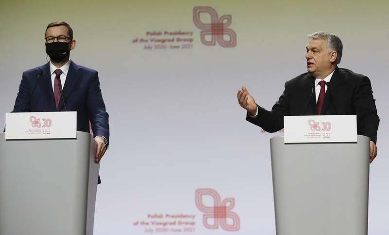 Prime Minister of Hungary Viktor Orban, right, and Polish Prime Minister Mateusz Morawiecki during a news conference at a meeting marking 30 years of central Europe's informal body of cooperation called the Visegrad Group, at a conference center in Krakow, Poland, Wednesday, Feb. 17, 2021. (AP Photo/Czarek Sokolowski)