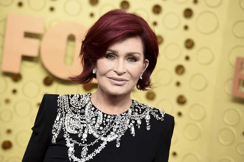 """FILE - Sharon Osbourne arrives at the 71st Primetime Emmy Awards on Sept. 22, 2019, in Los Angeles. CBS says Sharon Osbourne will no longer appear on its daytime show """"The Talk"""" after a heated on-air discussion about racism earlier this month. (Photo by Jordan Strauss/Invision/AP, File)"""