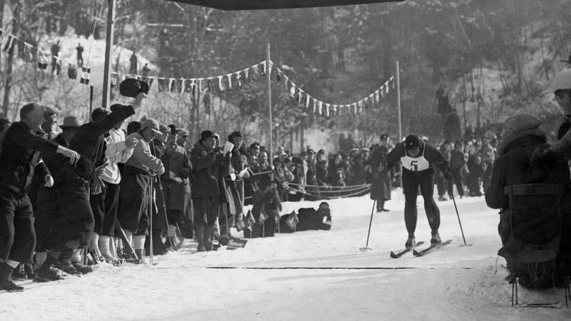A German cross-country skier approaches the finishing line at the 1936 Winter Games.