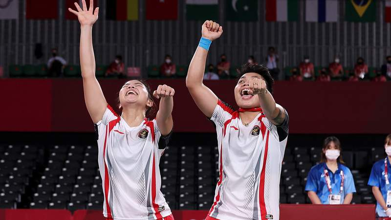 Greysia Polii(left) and Apriyani Rahayu of Indonesia celebrate as they win against Chen Qingchen and Jia Yifan of China during the Womens Doubles Gold Medal match on day ten of the Tokyo 2020 Olympic