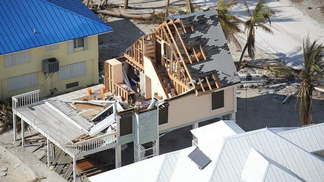 A damaged home and streets littered with debris are seen after Hurricane Irma passed through the area on Sept. 13, 2017 in Ramrod Key, Florida (Joe Raedle/Getty Images).