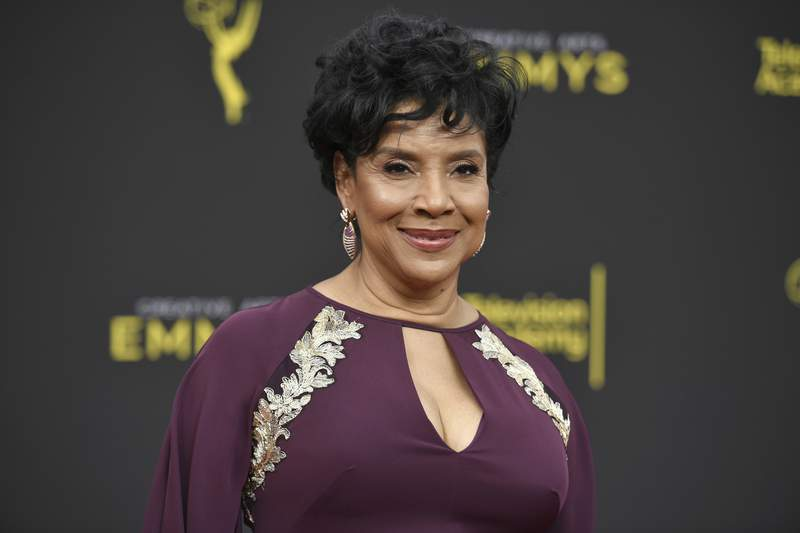 FILE - Phylicia Rashad arrives at the Creative Arts Emmy Awards in Los Angeles on Sept. 15, 2019. Rashad is returning to her alma mater as the new dean of the Howard University College of Fine Arts. The longtime performer and Tony Award winner who role to cultural prominence as Clair Huxtable on The Cosby Show graduated magna cum laude from Howard with a bachelors in fine arts in 1970. (Photo by Richard Shotwell/Invision/AP, File)