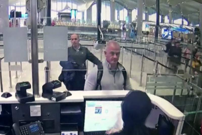 FILE This Dec. 30, 2019 image from security camera video shows Michael L. Taylor, center, and George-Antoine Zayek at passport control at Istanbul Airport in Turkey. Two Americans, Taylor and his son Peter, charged in Japan with helping Nissans former chairman, Carlos Ghosn, jump bail and escape Japan for Lebanon apologized Tuesday, June 29, 2021, in a Tokyo court. (DHA via AP, File)