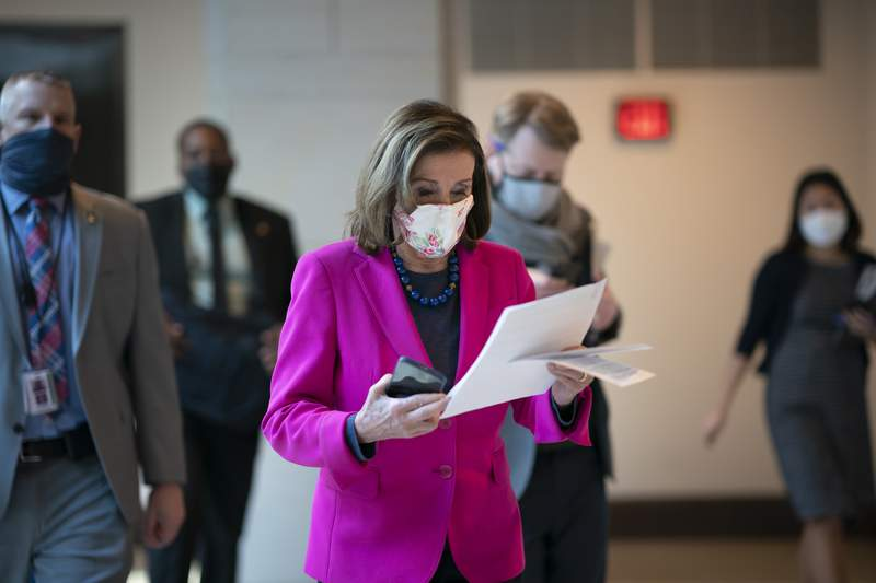 Speaker of the House Nancy Pelosi, D-Calif., walks to a news conference as the Democratic-led House is poised to pass a bill that enshrines protections in the nation's labor and civil rights laws for LGBTQ people, a top priority of President Joe Biden, at the Capitol in Washington, Thursday, Feb. 25, 2021. (AP Photo/J. Scott Applewhite)