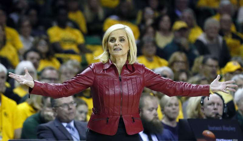 FILE - In this Thursday, March 5, 2020 file photo, Baylor head coach Kim Mulkey questions a call from the sidelines during an NCAA college basketball game against Texas in Waco, Texas. Hall of Fame coach Kim Mulkey has left Baylor to return home and take over the LSU women's basketball team. The school announced the move Sunday, April 25, 2021. (AP Photo/Ray Carlin, File)