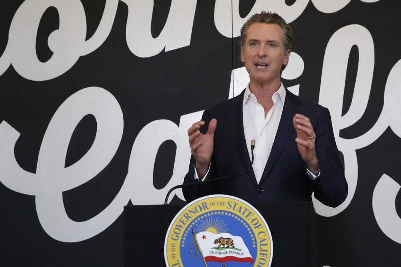 FILE - In this May 5, 2020 file photo, California Gov. Gavin Newsom discusses his plan for the gradual reopening of California businesses during a news conference at the Display California store in Sacramento, Calif. While President Donald Trump claims mail-in voting is ripe for fraud and cheaters, his reelection campaign and state allies are scrambling to launch operations meant to help their voters cast ballots in the mail. Newsom, a Democrat, has announced that the states 20.6 million voters will be mailed ballots before Election Day.  (AP Photo/Rich Pedroncelli, Pool, File)