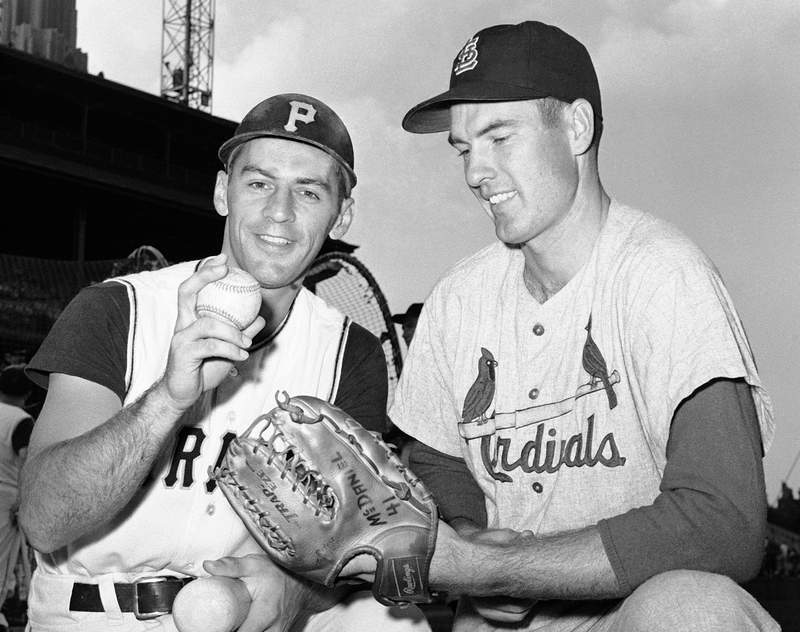 FILE - In this Aug. 11, 1960, file photo, shortstop Dick Groat, left, of the Pittsburgh Pirates, and pitcher Lindy McDaniel, of the St. Louis Cardinals, talk at Forbes Field in Pittsburgh. McDaniel, an All-Star reliever who appeared in nearly 1,000 major league games over 21 seasons, has died. He was 84. (AP Photo/File)
