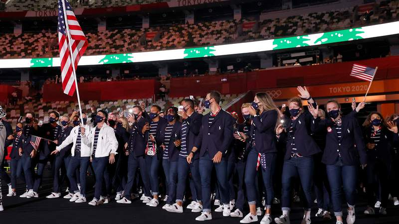Sue Bird and Eddy Alvarez lead the USA during the Parade of Nations.
