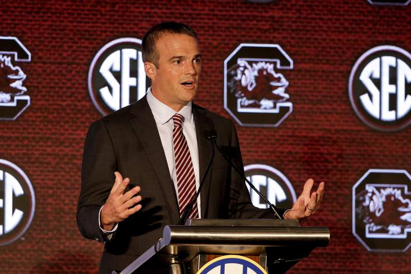 FILE - South Carolina head coach Shane Beamer speaks to reporters during the NCAA college football Southeastern Conference Media Days in Hoover, Ala., in this Monday, July 19, 2021, file photo. First-year South Carolina coach Shane Beamer believes is new team is closer to the dominance it showed a decade ago than the way it performed the past couple of seasons. (AP Photo/Butch Dill, File)