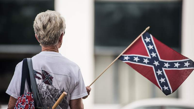A woman shows her support for the Confederate battle flag at the South Carolina state house July 8, 2015 in Columbia, South Carolina.