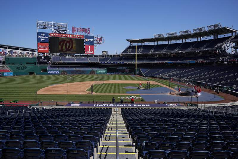 The Washington Nationals have a baseball workout at Nationals Park, Monday, April 5, 2021, in Washington. The Nationals had a conronavirus outbreak that sidelined 11 players, four of whom tested positive for COVID-19, and delayed their first game until Tuesday. (AP Photo/Alex Brandon)