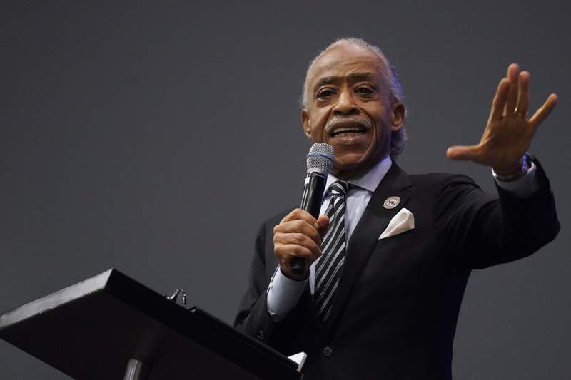 FILE - In this May 3, 2021 file photo, Rev. Al Sharpton speaks during the funeral for Andrew Brown Jr.at Fountain of Life Church in Elizabeth City, N.C. Brown was fatally shot by Pasquotank County Sheriff deputies trying to serve a search warrant.  Many police departments  including in large U.S. cities such as New York and Chicago  ban or strictly limit shooting into moving vehicles after concluding that the practice is ineffective and not worth the risk to human life. But it is still happening and defended as a justifiable use of force in other areas, including the small municipality of Elizabeth City. (AP Photo/Gerry Broome, File)