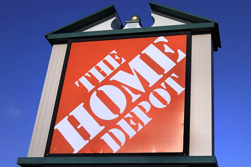FILE - A Home Depot store sign is visible from Route 102, Wednesday, Nov. 18, 2020, in Londonderry, N.H.  Home Depot Inc. will pay a $20.8 million fine for failing to ensure that its contractors follow lead paint rules. The civil penalty announced Thursday, Dec. 17,  by the Environmental Protection Agency is the largest such penalty to date under the Toxic Substances Control Act.  (AP Photo/Charles Krupa, File)