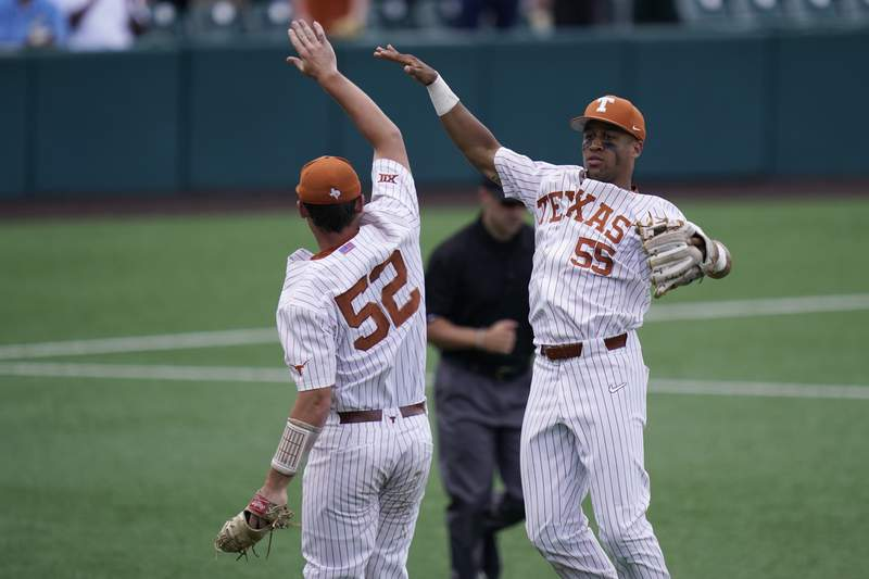 Texas pitcher Zach Zubia (52) and third baseman Camryn Williams (55) celebrate after their win over Southern in an NCAA regional tournament college baseball game, Friday, June 4, 2021, in Austin, Texas. (AP Photo/Eric Gay)