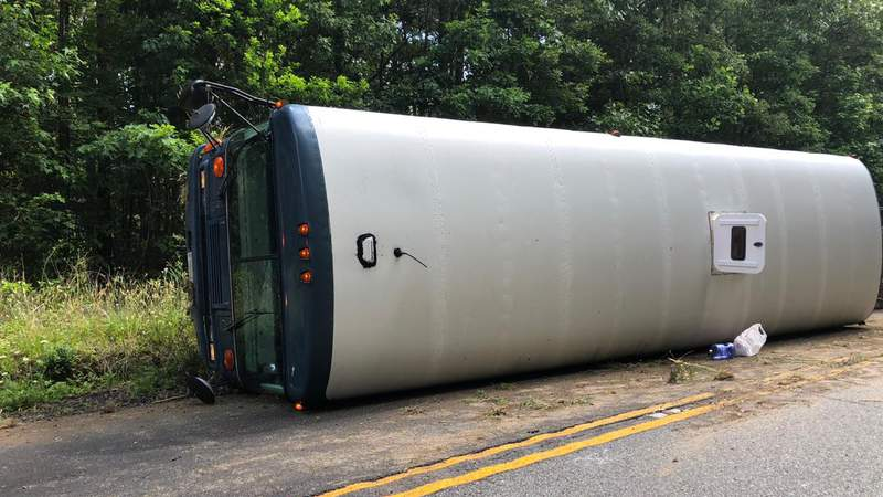 Bus carrying National Guard soldiers overturns, 14 injured
