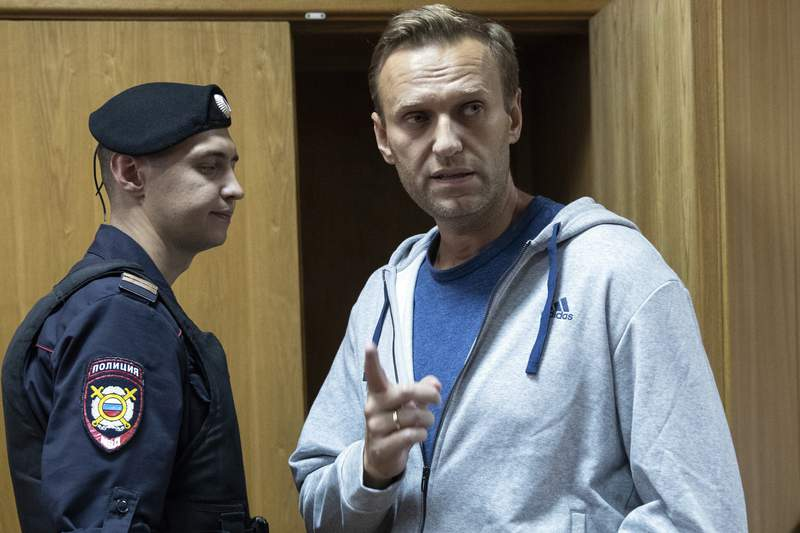 FILE - In this Monday, Aug. 27, 2018 file photo, Russian opposition leader Alexei Navalny gestures while speaking in a court room in Moscow, Russia. (AP Photo/Pavel Golovkin, File)
