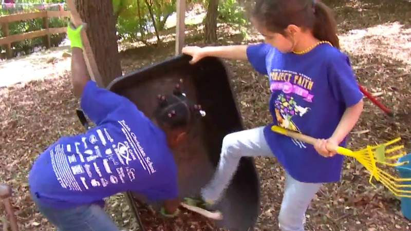 Faith Christian School students help clean and make repairs at Mill Mountain Zoo