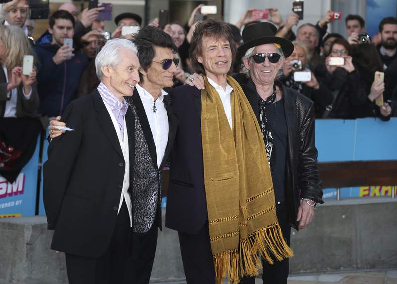 FILE - This April 4, 2016 file photo shows members of The Rolling Stones, from left, Charlie Watts, Ronnie Wood, Mick Jagger and Keith Richards at the Rolling Stones Exhibitionism preview in London. The Rolling Stones will join Lady Gaga, Paul McCartney, Stevie Wonder and Billie Eilish for the upcoming TV special aimed at fighting the coronavirus pandemic. Advocacy organization Global Citizen announced Friday that the Stones will appear Saturday on One World: Together At Home, a two-hour televised event that will air at 8 p.m. Eastern simultaneously on ABC, NBC, CBS, iHeartMedia and Bell Media networks. (Photo by Joel Ryan/Invision/AP, File)