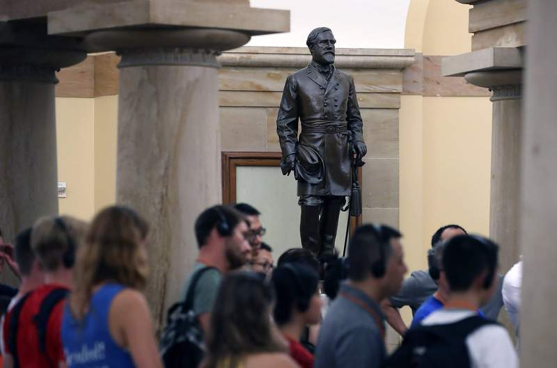 WASHINGTON, DC - AUGUST 17: Tourists walk past the Statue of Confederate General Robert E. Lee that is located inside the US Capitol August 17, 2017 in Washington, DC. House Minority Leader Nancy Pelosi (D-CA) has called for the removal of all Confederate statues from the United States Capitol.  (Photo by Mark Wilson/Getty Images)