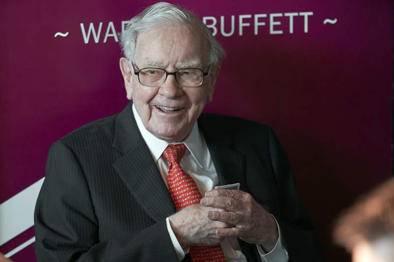FILE - In this May 5, 2019, file photo Warren Buffett, Chairman and CEO of Berkshire Hathaway, smiles as he plays bridge following the annual Berkshire Hathaway shareholders meeting in Omaha, Neb. A multitude of big-name businesses and high-profile individuals, including Buffett, Amazon and Facebook are showing their support for voters rights. In a letter published in The New York Times, the group stressed that Americans should be allowed to cast ballots for the candidates of their choice. For American democracy to work for any of us, we must ensure the right to vote for all of us, they wrote. (AP Photo/Nati Harnik, File)