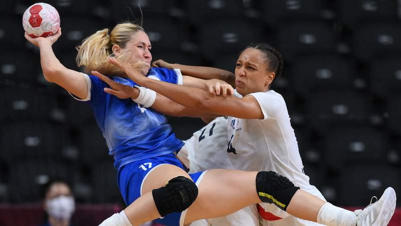 Russian Olympic Committee left back Vladlena Bobrovnikova is challenged by France's pivot Beatrice Edwige during the women's final handball match between Russia and France at the Tokyo 2020 Olympic Games.