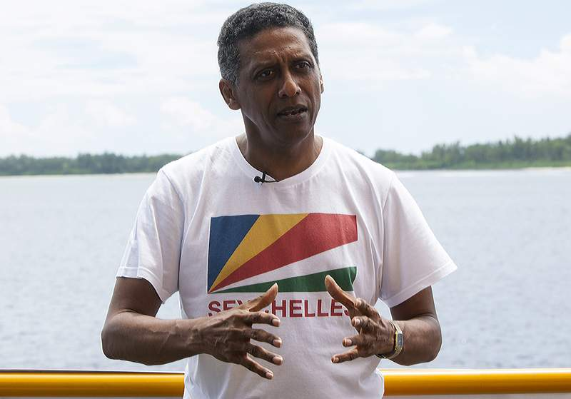 FILE - In this Sunday April 14, 2019 file photo, Seychelles President Danny Faure speaks during an interview with the Associated Press, on the island of Desroches, Seychelles. The Seychelles presidential election has seen an upset, with the electoral commission on Sunday, Oct. 25, 2020 declaring longtime opposition contender Wavel Ramkalawan the winner over incumbent Danny Faure. The ruling party has been knocked from power for the first time since 1977. (AP Photo/Steve Barker, file)