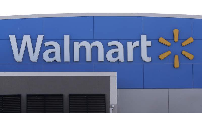 FILE - In this Tuesday, Sept. 3, 2019, file photo, A Walmart logo is attached to the outside of a Walmart store in Walpole, Mass. Walmart says it has removed ammunition and firearms from displays at U.S. stores, citing civil unrest in some areas. The nations largest retailer, based in Bentonville, Arkansas,  sell firearms in about half of its 4,700 stores. (AP Photo/Steven Senne, File)