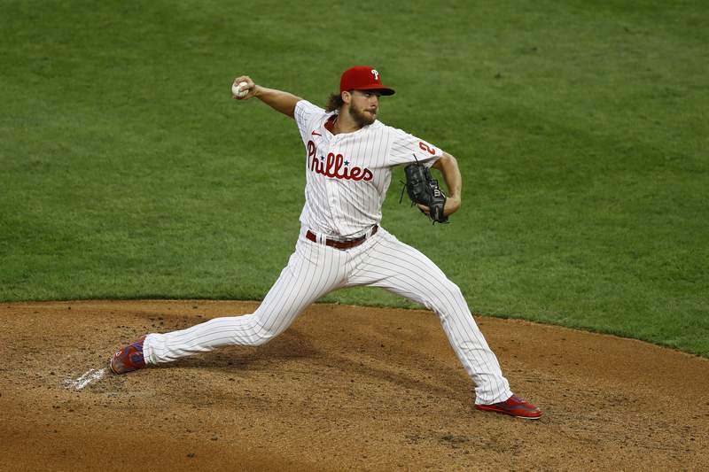 Philadelphia Phillies' Aaron Nola pitches during the first inning of the second baseball game in a doubleheader against the New York Yankees, Wednesday, Aug. 5, 2020, in Philadelphia. (AP Photo/Matt Slocum)