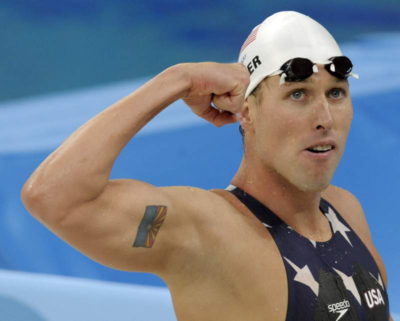 FILE - In this  Tuesday, Aug. 12, 2008 file photo, United States' relay swimmer Klete Keller reacts after a men's 4x200-meter freestyle relay heat during the swimming competitions in the National Aquatics Center at the Beijing 2008 Olympics in Beijing. Five-time Olympic swimming medalist Klete Keller was charged Wednesday, Jan. 13, 2021  with participating in a deadly riot at the U.S. Capitol after video emerged that appeared to show him among those storming the building last week. (AP Photo/Thomas Kienzle, File)